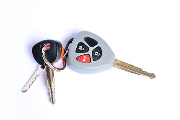 Car key with remote buttons on white background