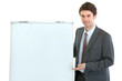 Happy businessman presenting something on flipchart stand