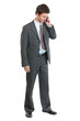 Full length portrait of businessman speaking mobile