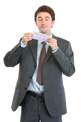 Happy businessman smiling 500 euros note