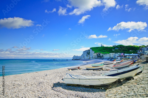 Etretat village, bay beach and boats. Normandy, France.