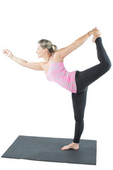 fitness woman make stretch on yoga and pilates pose