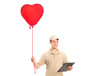 A delivery boy delivering a red heart shaped balloon