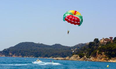 parasailing and boat