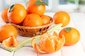 tangerines with leaves in a beautiful basket,