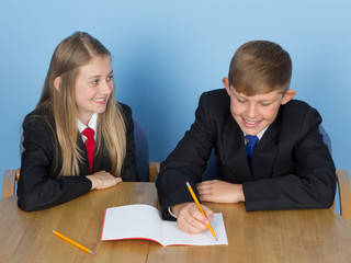 Two schoolchildren doing homework