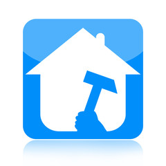 Home renovations icon with house and hammer