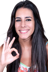 woman smiling doing the okay sign