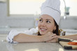 Cute female chef daydreaming