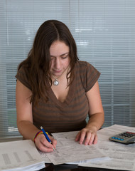 Young lady preparing USA tax form 1040 for 2012