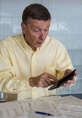 Senior man preparing USA tax form 1040 for 2012
