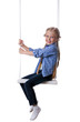 Happy blonde girl sitting on swing