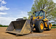 Leinwanddruck Bild - Yellow construction bulldozer