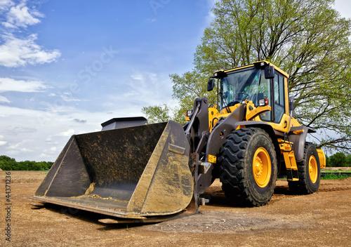 Leinwanddruck Bild Yellow construction bulldozer