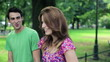 Happy couple in love walking in the park, steadicam shot