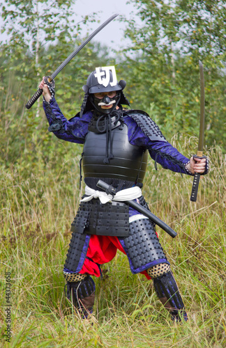 Samurai in armor with two swords
