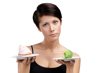 Woman doubts between tasty tart and healthy cabbage