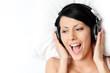 Woman in bra listens to music through the black headphones