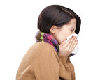 Sneezing young woman holding wipe in her hands, isolated