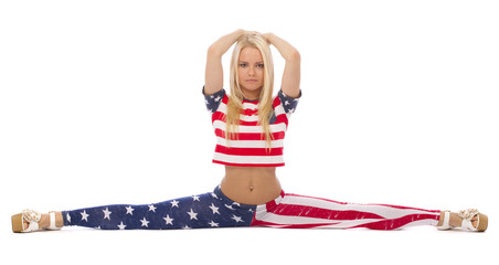 Attractive blonde girl in USA clothes sitting on twine