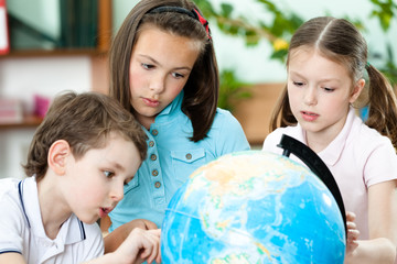Pupils stare at the school terrestrial globe