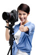 Woman takes photos holding photographic camera