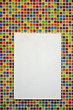 Blank paper board on colorful mosaic wall