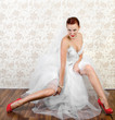 Portrait of young beautiful bride in shoes