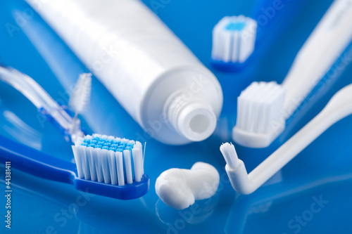 various toothbrushes and paste