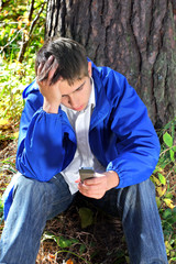 sad young man with phone