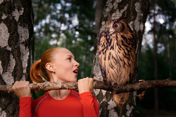 Red woman with big owl
