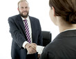 beard business man brunette woman at desk handshake