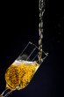 Beer pouring in a glass on black background