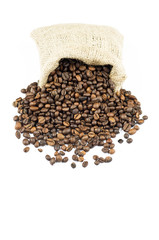 Studio shot of coffee beans flowing out from a bag.