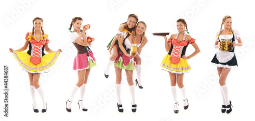 Six young women in Bavarian clothes holding fresh beer