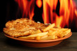 Roast chicken cutlet with french fries,  on fire background