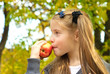 Little girl eating apple