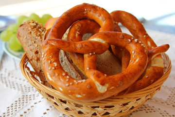 A basket of Fresh Bavarian Pretzel (Brezel) and other breads