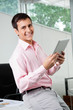 Business Executive Holding Digital Tablet