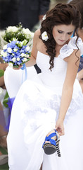 Portrait of young bride with flower bouquet.