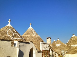 Typical trulli houses with conical roof in Alberobello, Italy