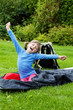 happy little girl resting in a sleeping bag - camping concept