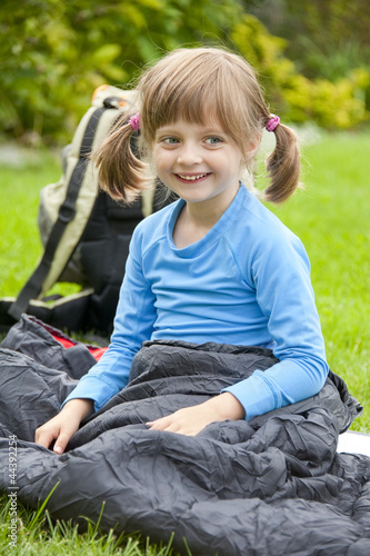 portrait of a little girl resting in a sleeping bag