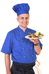 Smiling chef with healthy low-calorie salad dish