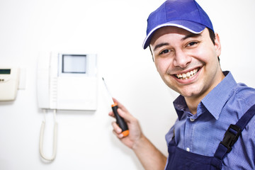 Smiling technician at work