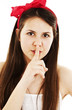 Portrait of teenage girl with silence sign on white background