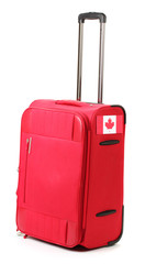 red suitcase with sticker with flag of Canada isolated on white