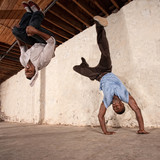 Capoeria Martial Artists Flipping