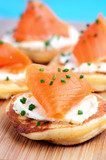 Smoked salmon canapes with chive garnish