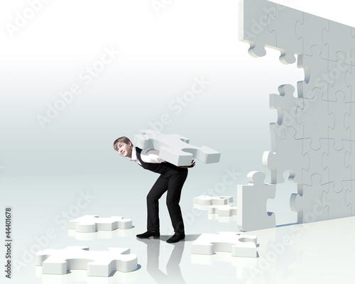 Businessman with a puzzle pieces